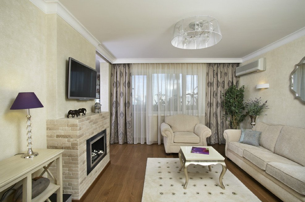 Дизайн комнаты с камином в квартире фото